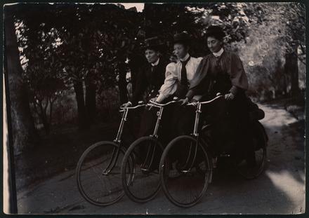 [Nurse Bessie, Nurse Pierce and unidentified nurse riding bicycles]
