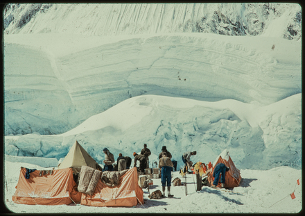 [Camp 111 at the top of the icefall, Nepal. Sir Edmund Hillary at left, John Hunt, centre, in braces]
