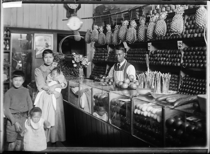 Chinese family in a greengrocer's shop