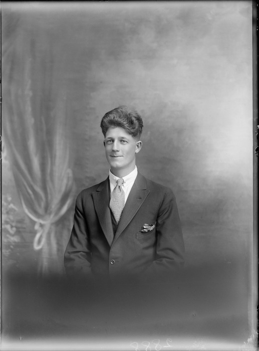 Studio upper torso portrait of unidentified man in suit and tie with lapel pocket handkerchief, with bouffant hairstyle, Christchurch