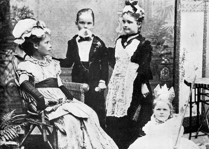 Four of the Beauchamp family children dressed up for their performance in a concert