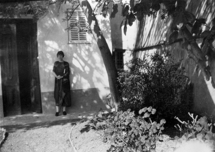 Katherine Mansfield standing in the garden at the Villa Isola Bella, Menton, France