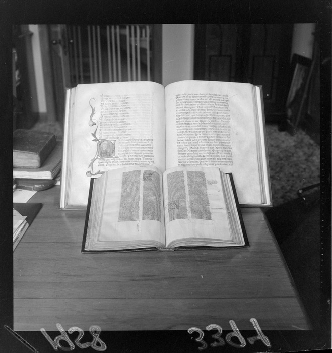 Display of illuminated manuscripts, with the item at the back being Boethius' Consolatio Philosphiae (Consolation of Philosophy) from the Alexander Turnbull Library collections