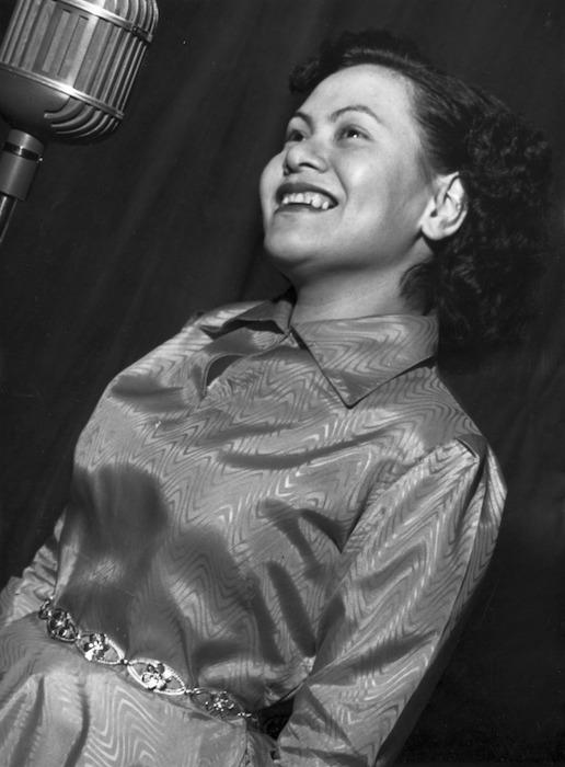 Mavis Chloe Rivers alongside a microphone