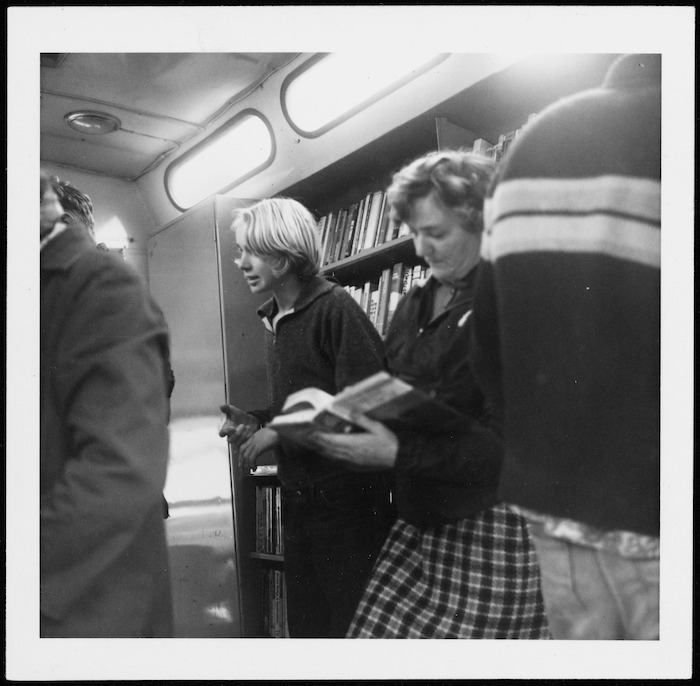 People selecting books in a Country Library Service Bookvan