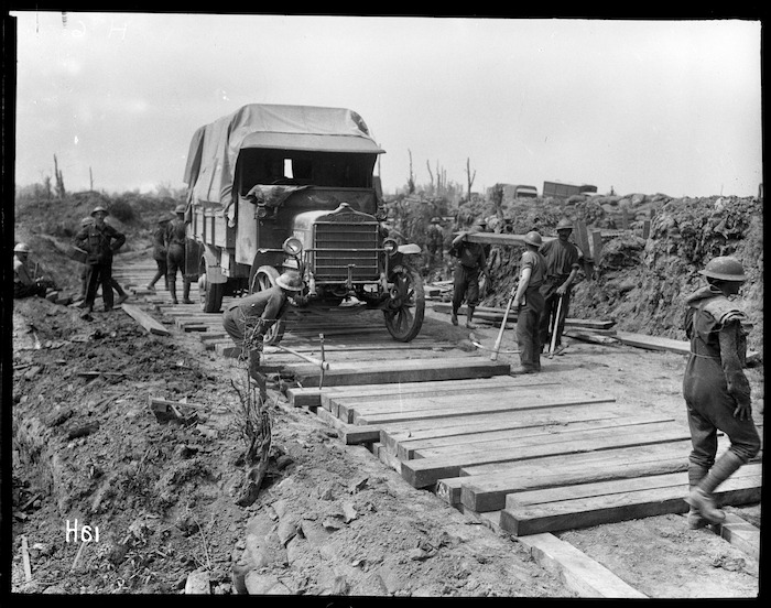 Members of the Pioneer Battalion laying a road in Messines, Belgium