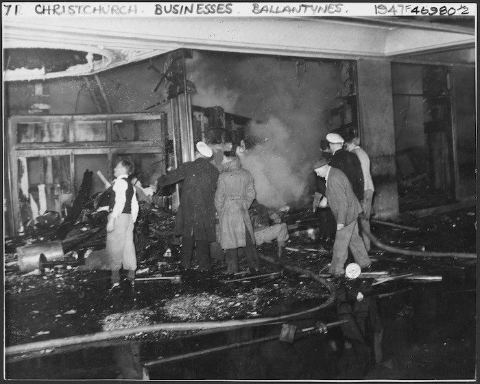 Workers in the burnt wreckage of Ballantyne's department store, trying to make an entrance to the basement