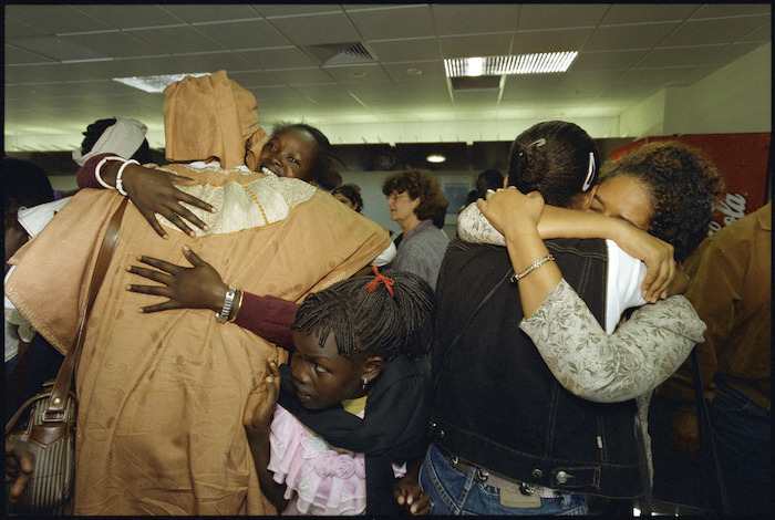 Ethiopian refugees Senayint Ayla and Meskerm Solomon embrace after reuniting at Wellington Airport - Photograph taken by Ross Giblin