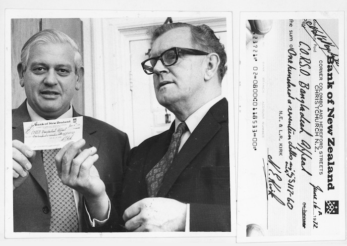 Leader of the opposition, Norman Kirk, handing a cheque for 1% of his gross salary to the director of CORSO, Haddon Charles Dixon, for the Bangladesh appeal