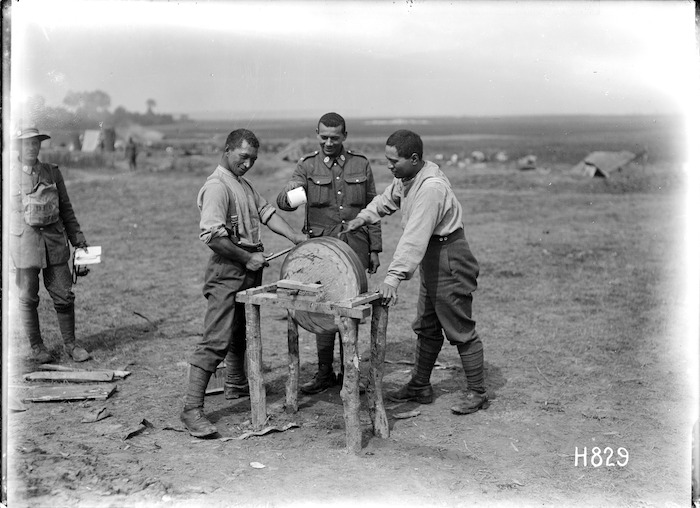 Members of the Maori Pioneer Battalion sharpening a hatchet at Bayencourt during World War I