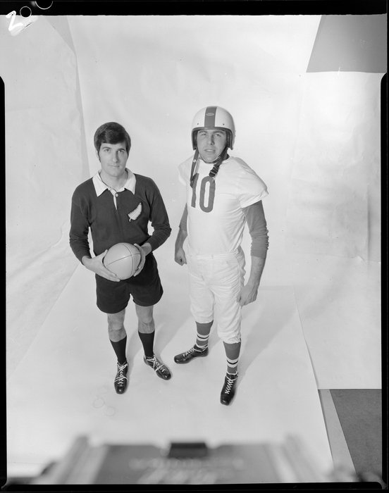 Two men in All Blacks and Gridiron uniforms
