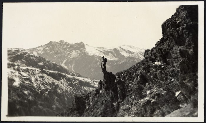 Creator unknown : Photograph of mountain ridges, and a deer hunter
