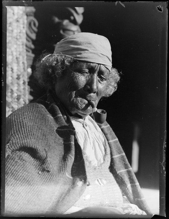 Portrait of an unidentified Maori woman smoking a pipe, Taupo