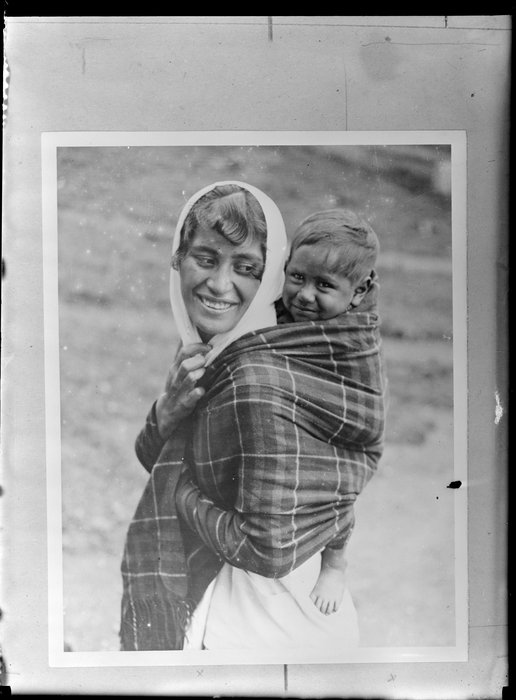 Annie Ngauru Hoko (nee Downs) woman carrying a young child on her back wrapped in a blanket