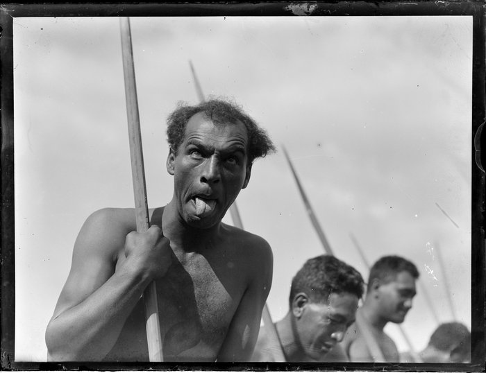 A Maori man doing the pukana during a performance, location unidentified