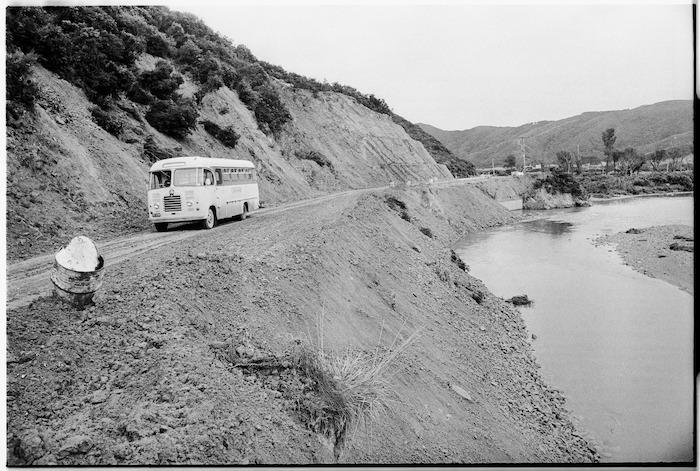 School bus on a road beside the Wainui Stream