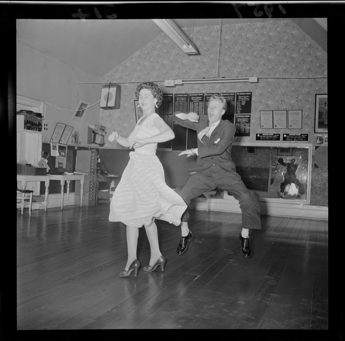 Mr Milton Mitchell and Mrs Jimmy James demonstrating rock & roll dancing, in a dance studio