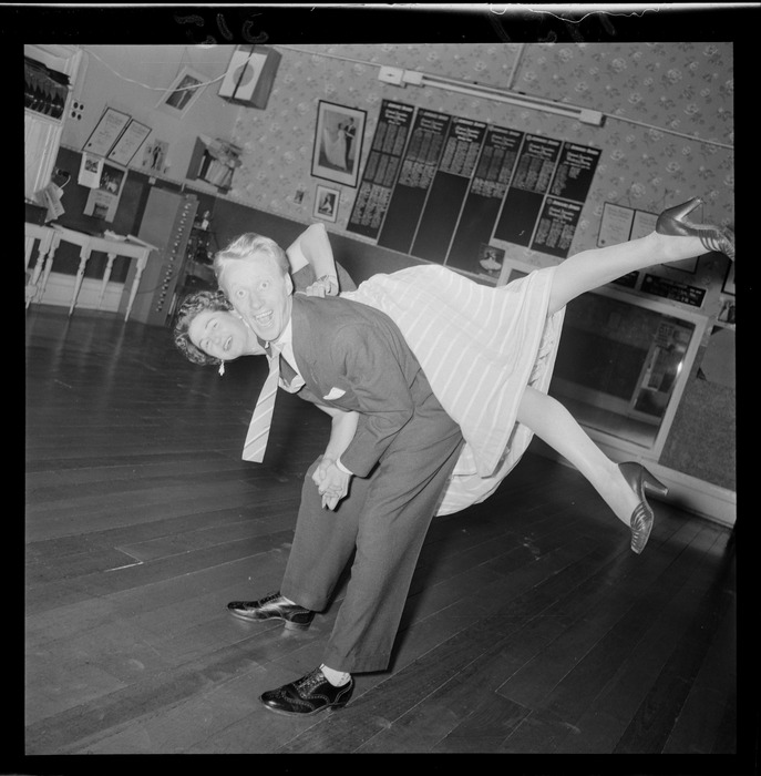 Mr Milton Mitchell and Mrs Jimmy James demonstrating rock roll dancing, in a dance studio