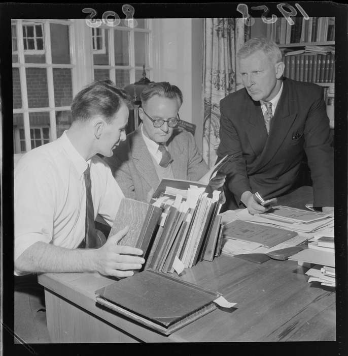 Manuscripts curator, Glen Barclay, Professor Ian Gordon and Chief Librarian, Mr C R H Taylor, looking at the journals of Katherine Mansfield, which have just arrived at the Alexander Turnbull Library, Wellington