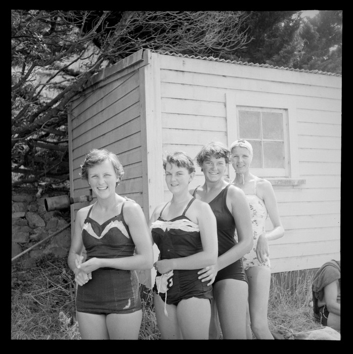 Women swimmers in their bathing costumes; participants in a swimming race between Somes/Matiu Island in Wellington Harbour and Petone, Lower Hutt