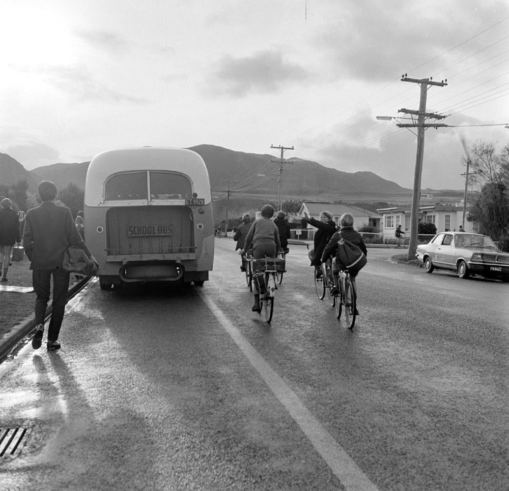 Upper Hutt College; cyclists and bus.