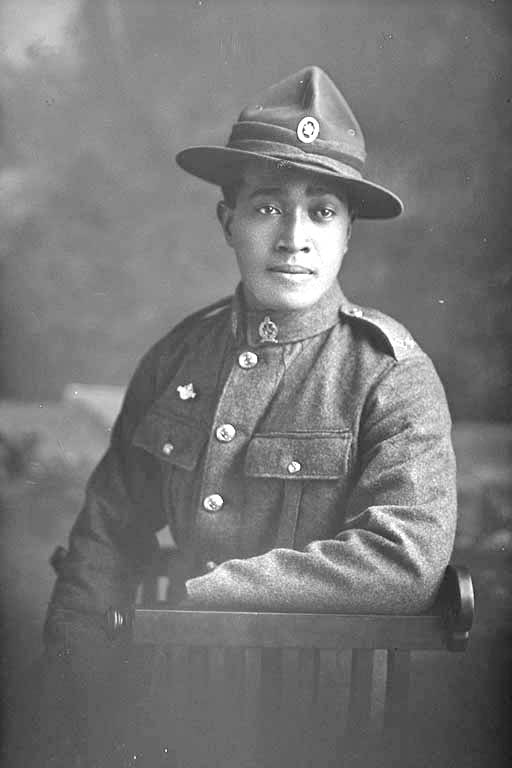 3/4 portrait of Private Florian of the Maori Contingent, New Zealand Maori Pioneer Battalion, wearing a New Zealand Returned Soldiers Association Badge