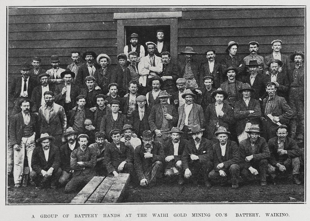 A GROUP OF BATTERY HANDS AT THE WAIHI GOLD MINING CO.'S BATTERY, WAIKINO.