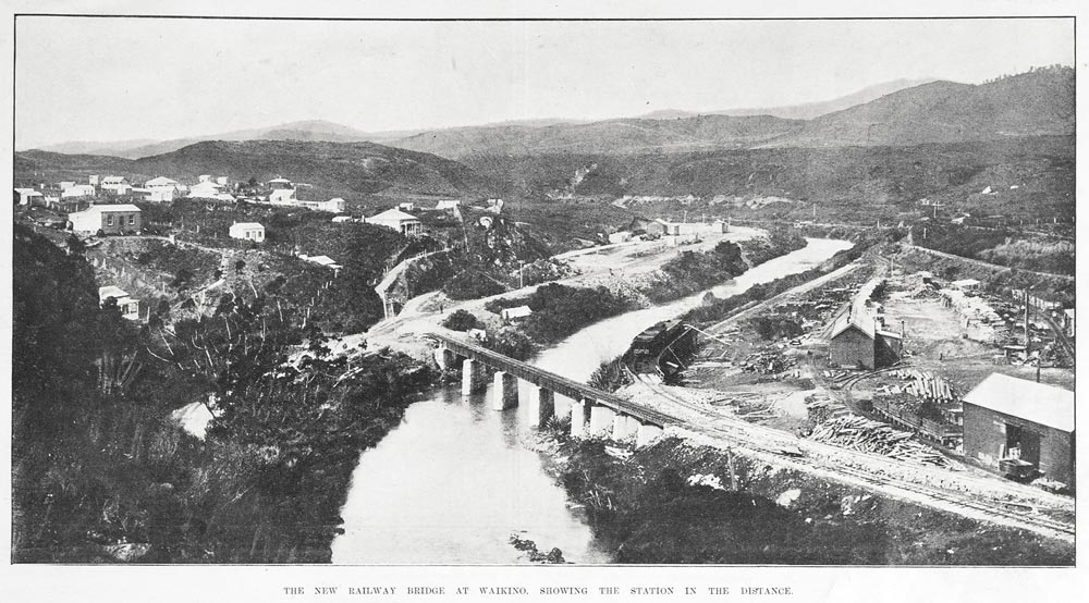 THE NEW RAILWAY BRIDGE AT WAIKINO. SHOWING THE STATION IN THE DISTANCE.