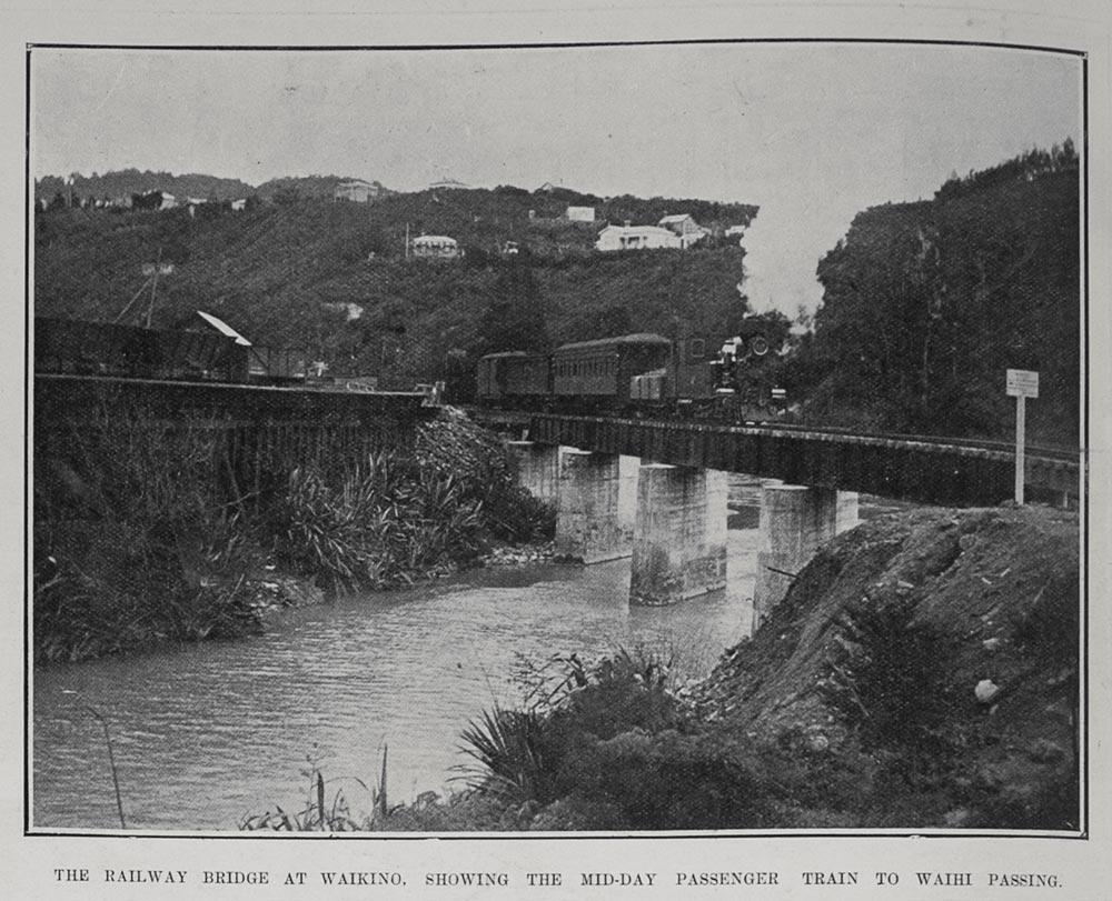 THE RAILWAY BRIDGE AT WAIKINO, SHOWING THE MID-DAY PASSENGER TRAIN TO WAIHI PASSING.