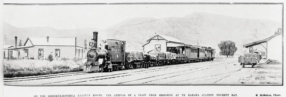 ON THE GISBORNE-ROTORUA RAILWAY ROUTE: THE ARRIVAL OF A TRAIN FROM GISBORNE AT TE KARAKA STATION, POVERTY BAY.