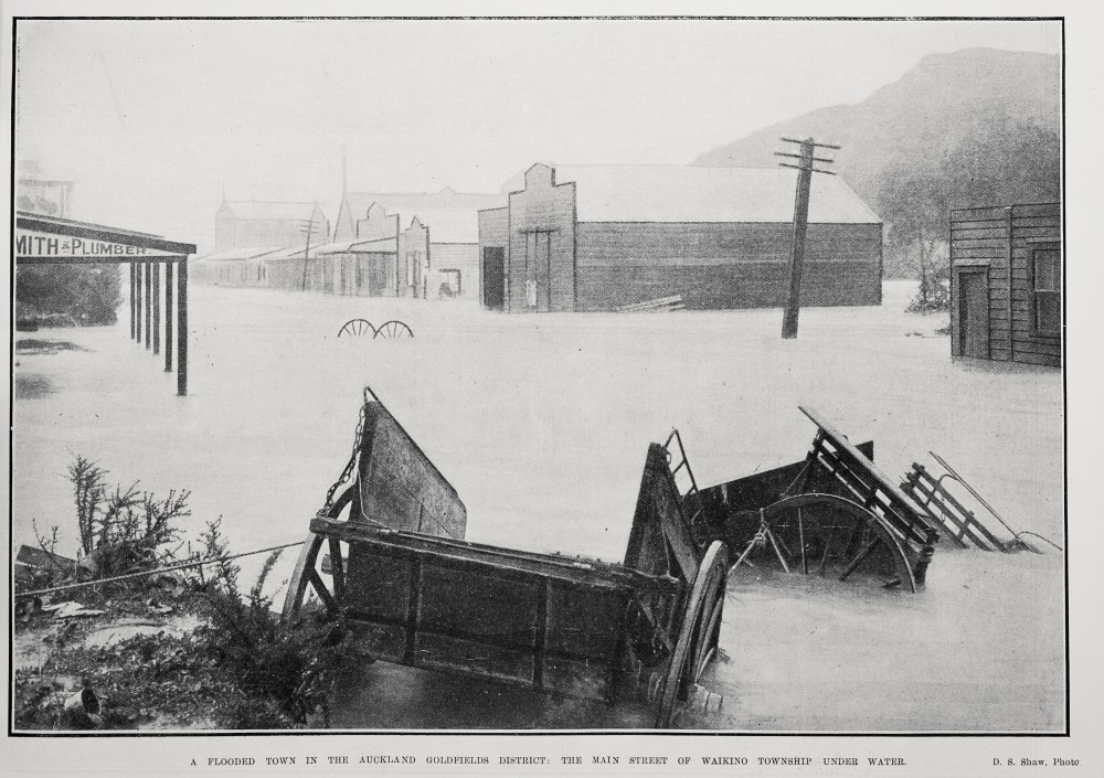A FLOODED TOWN IN THE AUCKLAND GOLDFIELDS DISTRICT: THE MAIN STREET OF WAIKINO TOWNSHIP UNDER WATER.