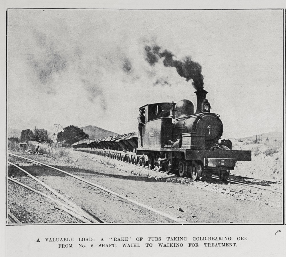 """A VALUABLE LOAD: A """"RAKE"""" OF TUBS TAKING GOLD-BEARING ORE FROM NO. 6 SHAFT, WAIHI, TO WAIKINO FOR TREATMENT."""