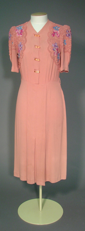 Day dress; pink fabric with floral details and braiding