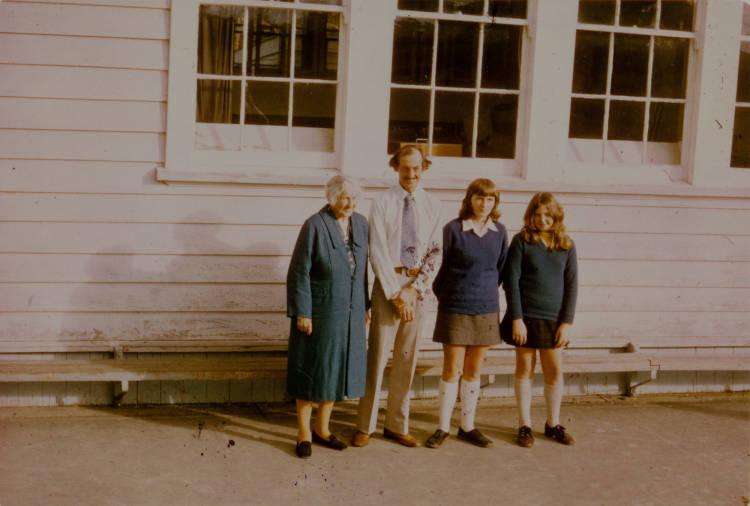 Three generations of the Stevenson family outside Albany School.