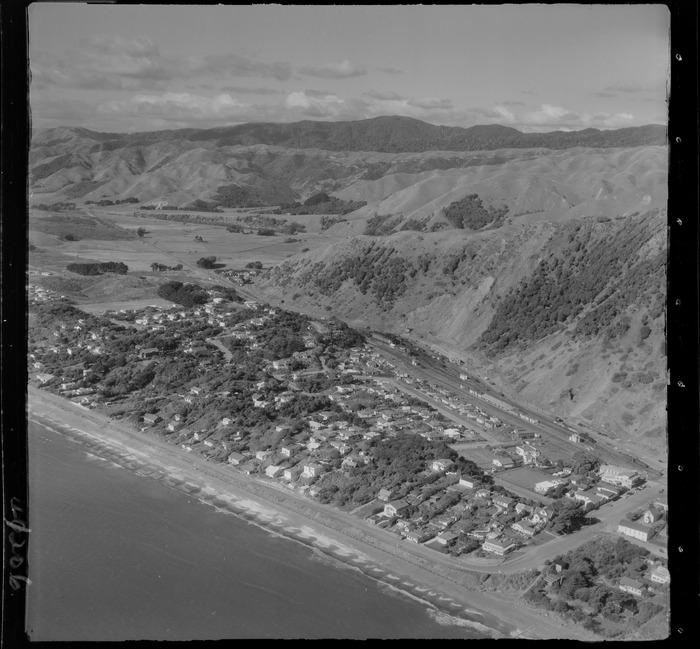 Paekakariki Beach coastal settlement with railway station and yards, Beach Road and The Parade road looking north, Kapiti Coast, Wellington Region