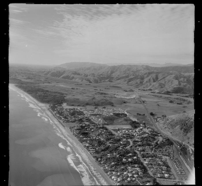 View north over the Kapiti coastal settlement of Paekakariki with Wellington Road and Paekakariki School, railway yards and State Highway 1, Wellington Region