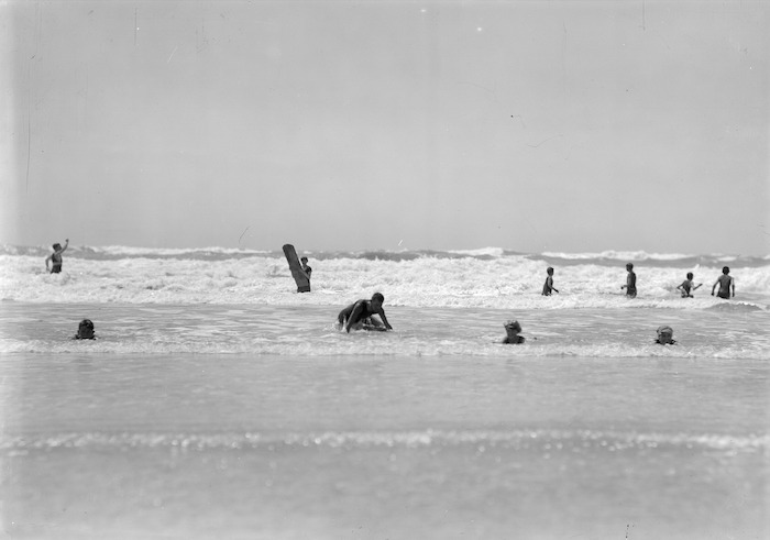 Surfers and swimmers, New Brighton beach, Christchurch