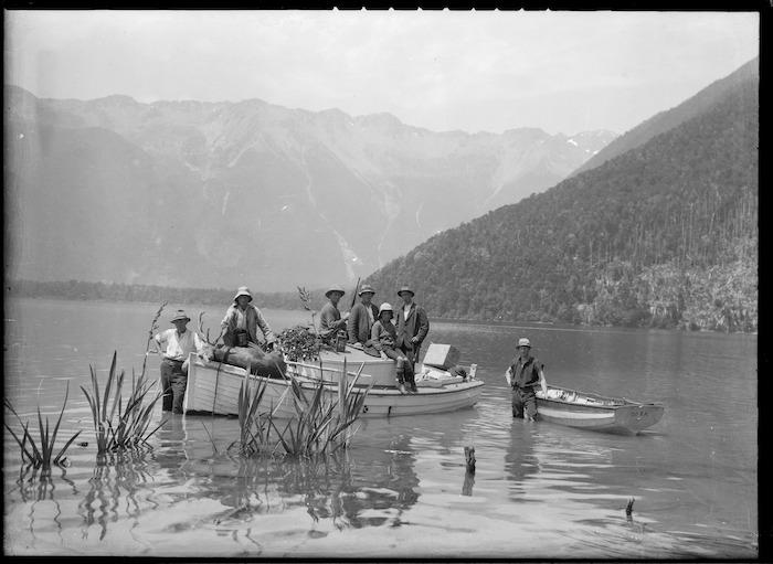 Deer hunters in a dinghy