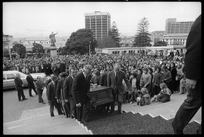 Prime Minister Norman Kirk's coffin being carried up the steps of Parliament
