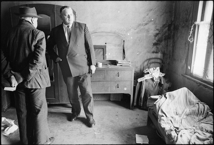 Leader of the Opposition Norman Kirk visiting the home of a pensioner, Te Aro, Wellington