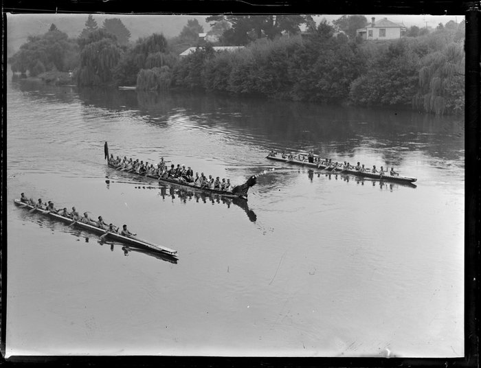 Three waka taua on the Waikato River [Royal visit?]