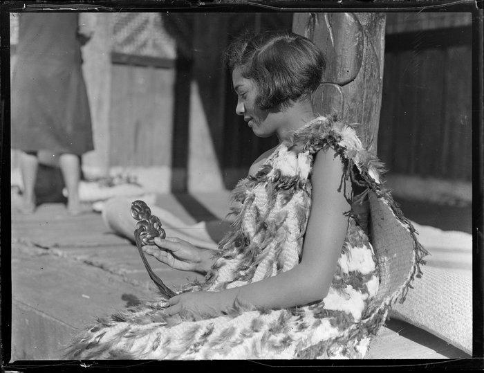 Molly Runga Raukura of Tokaanu dressed in a kahu huruhuru and holding a hei tiki