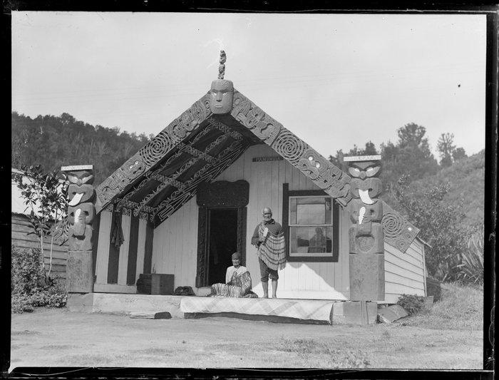Woman and man outside the Manuhuia meeting house, Lake Rotoiti