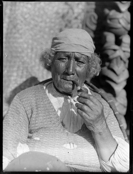 Portrait of an unidentified Māori woman smoking a pipe, Taupō