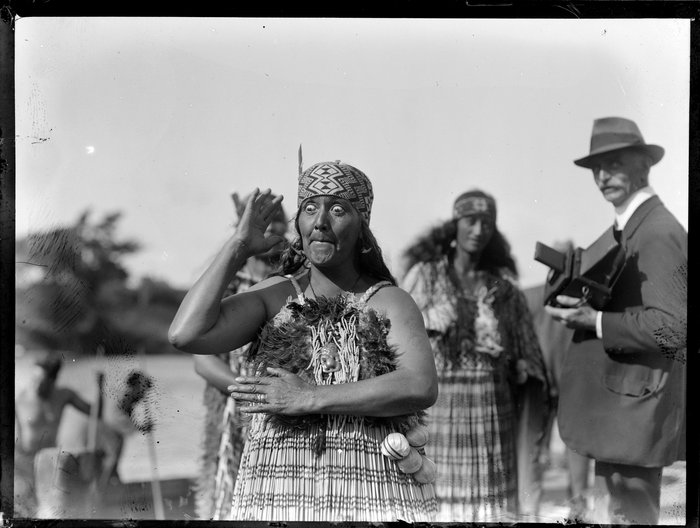 Unidentified Maori woman performing an action song, location unidentified