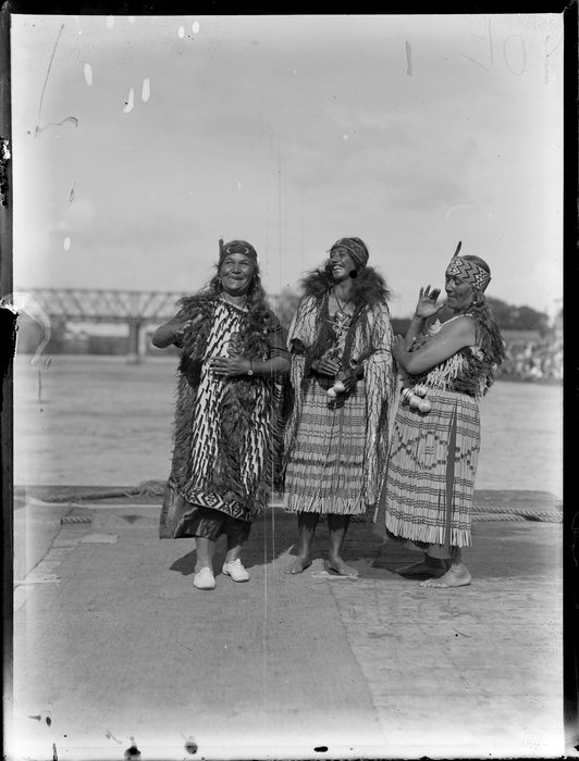 Three Māori women, including Bella Te Hoari Papakura, performing a waiata, Waikato