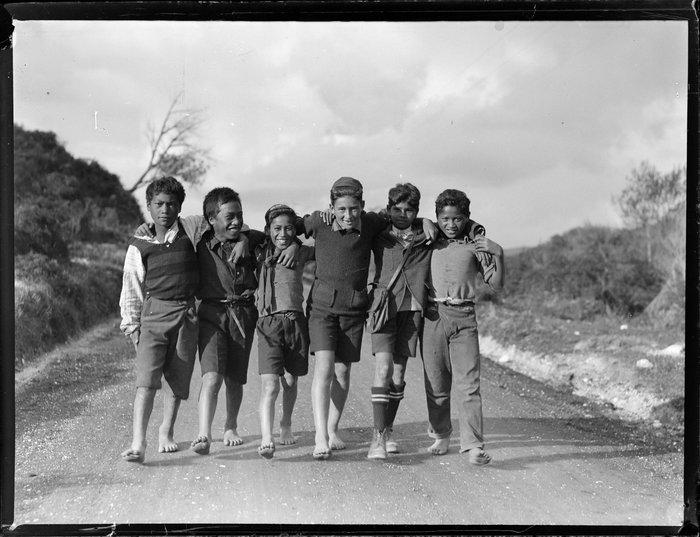 Māori boys walking down a road, Waikato