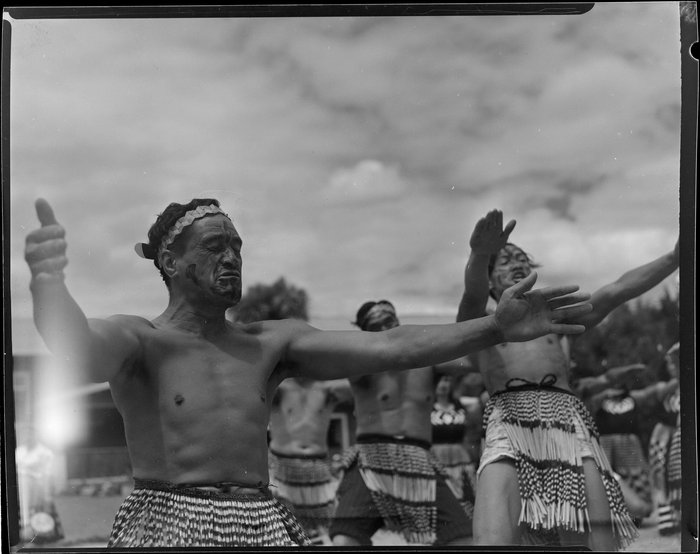 Maori men performing Haka dance at the welcoming ceremony of Sir Peter Buck, Ngaruawahia, Waikato