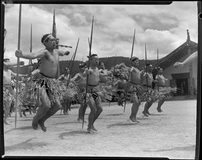Group of unidentified Maori doing Haka at Sir Peter Bucks welcoming ceremony