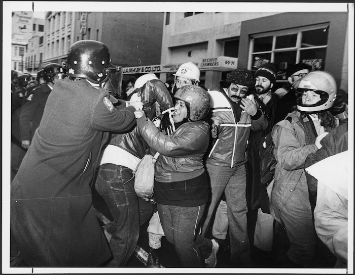 Scuffle between a policeman of the Red Squad and anti Springbok rugby tour demonstrators in Wellington - Photographs taken by Peter Avery
